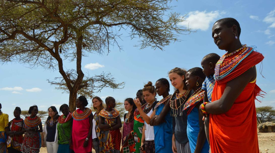 Volunteers visit a traditional village in Kenya during their volunteer trip abroad